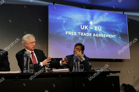 """David Davis, Britain's former Secretary of State for Exiting the European Union speaks flanked by Sir Rocco Forte the chairman of Sir Rocco Forte Hotels as they take part in the launch of an event for a proposed """"Comprehensive Free Trade Agreement between the UK and the European Union"""" at the Queen Elizabeth II Conference Centre in London,. Following talks with Northern Ireland's political parties Wednesday, Prime Minister Theresa May plans to meet with European leaders in Brussels on Thursday seeking changes to the so called Irish backstop, before Britain leaves the EU on upcoming March 29"""
