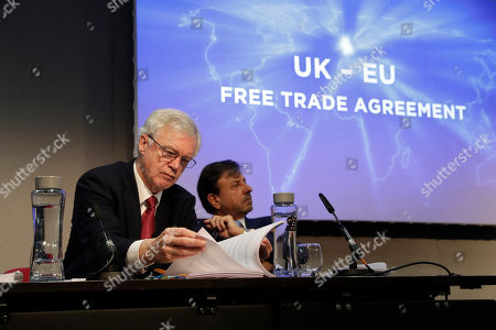"""David Davis, left, Britain's former Secretary of State for Exiting the European Union and Sir Rocco Forte the chairman of Sir Rocco Forte Hotels take part in the launch of an event for a proposed """"Comprehensive Free Trade Agreement between the UK and the European Union"""" at the Queen Elizabeth II Conference Centre in London,. Following talks with Northern Ireland's political parties Wednesday, Prime Minister Theresa May plans to meet with European leaders in Brussels on Thursday seeking changes to the so called Irish backstop, before Britain leaves the EU on upcoming March 29"""