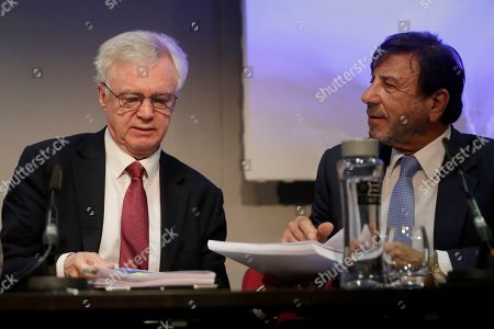 """Stock Picture of David Davis, left, Britain's former Secretary of State for Exiting the European Union and Sir Rocco Forte the chairman of Sir Rocco Forte Hotels speak as they finish the launch of an event for a proposed """"Comprehensive Free Trade Agreement between the UK and the European Union"""" at the Queen Elizabeth II Conference Centre in London,. Following talks with Northern Ireland's political parties Wednesday, Prime Minister Theresa May plans to meet with European leaders in Brussels on Thursday seeking changes to the so called Irish backstop, before Britain leaves the EU on upcoming March 29"""