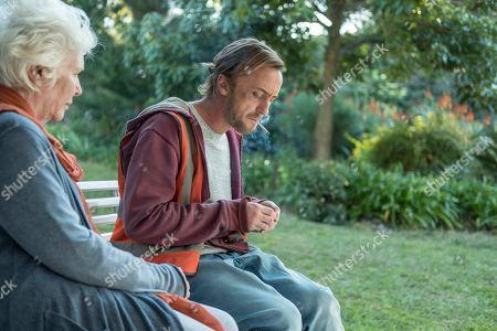 Fionnula Flanagan as Mia Anderson and Tom Felton as Logan