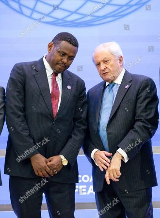 Ethiopia's Minister of Foreign Affairs Markos Tekle Rike (L) speaks with Spain's State Secretary for Foreign Affairs Fernando Martin Valenzuela Marzo (R) during a 'family photograph' during the Meeting of Foreign Ministers of the Global Coalition to Defeat ISIS at the US State Department in Washington, DC, USA, 06 February 2019. The 79-member coalition is meeting for in-depth discussions regarding defeating ISIS in Iraq and Syria.