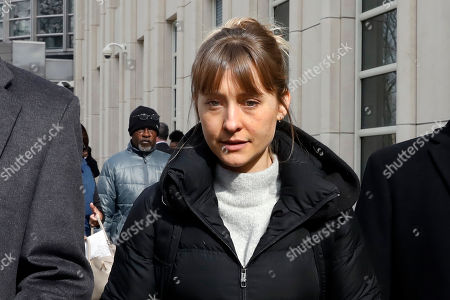Allison Mack leaves Brooklyn federal court, in New York, . She is a co-defendant in a case against an upstate New York group called NXIVM, accused of branding some of its female followers and forcing them into unwanted sex