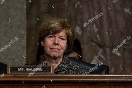 Senator Tammy Baldwin, Democrat of Wisconsin, listens to testimony from a witness during a Senate Commerce Committee hearing on Capitol Hill