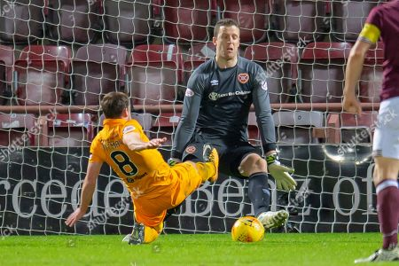 Goalkeeper Colin Doyle (#13) of Heart of Midlothian makes a save from Scott Pittman (#8) of Livingston FC during the Ladbrokes Scottish Premiership match between Heart of Midlothian and Livingston at Tynecastle Stadium, Edinburgh