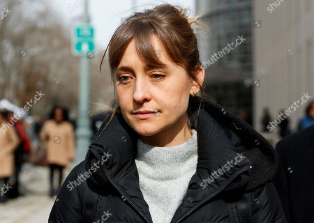 Actress Allison Mack (C) departs United States Federal Court after a hearing in the case against her in which she accused of helping to run an alleged sex cult in Brooklyn, New York, USA, 06 February 2019. Mack is accused along with defendant Keith Raniere, of participating in the alleged Nxivm sex cult.