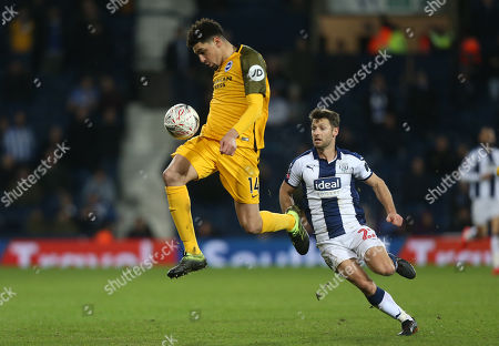 Leon Balogun of Brighton controls the ball under pressure from West Bromwich Albion's Wes Hoolahan