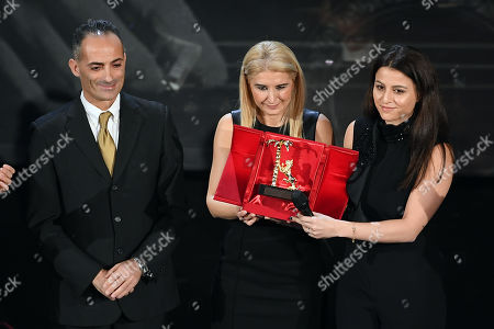 Stock Photo of President of town council of Sanremo Alessio Del Grande, daughters of Pino Daniele Cristina and Sara Daniele, during the Carreer Prize in memory of Pino Daniele
