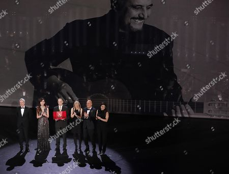 Stock Image of Italian singer and Sanremo Festival artistic director Claudio Baglioni, Italian actress Virginia Raffaele, Alessandro Il Grande, Cristina Daniele, Sara Daniele and Italian actor Claudio Bisio during the lifetime achievement award to Italian singer Pino Daniele on stage at the Ariston theatre during the 69th Sanremo Italian Song Festival, Sanremo, Italy, 06 February 2019. The Festival runs from 05 to 09 February.