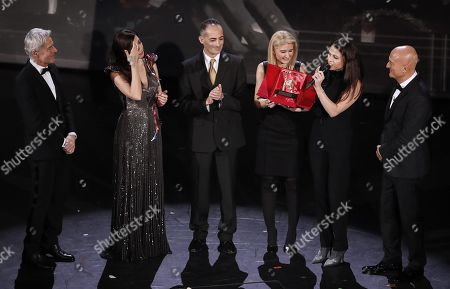 Italian singer and Sanremo Festival artistic director Claudio Baglioni, Italian actress Virginia Raffaele, Alessandro Il Grande, Cristina Daniele, Sara Daniele and Italian actor Claudio Bisio during the lifetime achievement award to Italian singer Pino Daniele on stage at the Ariston theatre during the 69th Sanremo Italian Song Festival, Sanremo, Italy, 06 February 2019. The Festival runs from 05 to 09 February.