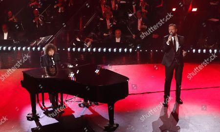 Riccardo Cocciante (L) and Gio' Di Tonno perform on stage at the Ariston theatre during the 69th Sanremo Italian Song Festival, Sanremo, Italy, 06 February 2019. The Festival runs from 05 to 09 February.