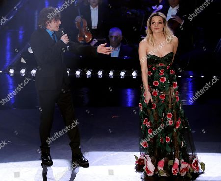 Laura Chiatti (R) and Michele Riondino (L) perform on stage at the Ariston theatre during the 69th Sanremo Italian Song Festival, Sanremo, Italy, 06 February 2019. The Festival runs from 05 to 09 February.