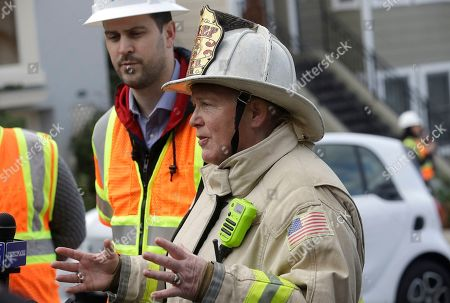 Stock Image of San Francisco fire chief Joanne Hayes-White gestures in front of Pacific Gas and Electric spokesperson Paul Doherty while speaking to reporters about a fire on Geary Boulevard in San Francisco