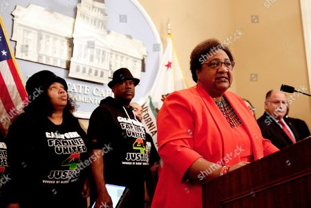 Stock Picture of Assemblywoman Shirley Weber, D-San Diego, discusses her bill that would allow police to use deadly force only when there is no reasonable alternative, during a news conference, in Sacramento, Calif. Weber's measure is one of two competing proposal over when police can use deadly force. Weber was accompanied by Beatrice Johnson, left and Cephus Johnson, center, the aunt and uncle of Oscar Grant who was killed by BART police n 2009