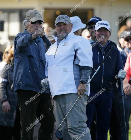 From left, Clint Eastwood, Daniel Lawrence Whitney, known professionally as Larry the Cable Guy, and Clay Walker prepare to hit from the first tee during the celebrity challenge event of the AT&T Pebble Beach National Pro-Am golf tournament, in Pebble Beach, Calif
