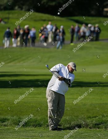 Daniel Lawrence Whitney, known professionally as Larry the Cable Guy hits his approach shot to the third green during the celebrity challenge event of the AT&T Pebble Beach National Pro-Am golf tournament, in Pebble Beach, Calif