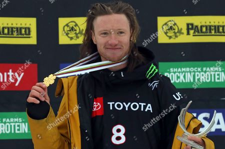 First place finisher James Woods celebrate on the podium following the men's Slopestyle World Championship, in Park City, Utah