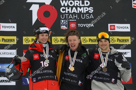James Woods, Birk Ruud, Nicholas Goepper. First-place finisher James Woods, center, of Britain, second-place Birk Ruud, left, of Norway; and third-place Nicholas Goepper, right, of the United States, celebrate on the podium following the men's slopestyle skiing world championship, in Park City, Utah