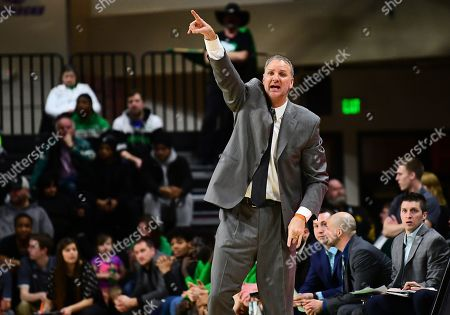 Stock Photo of North Dakota Fighting Hawks head coach Brian Jones directs his team during a NCAA men's basketball game between the North Dakota State Bison and the University of North Dakota Fighting Hawks at the Betty Engelstad Sioux Center, Grand Forks, ND. NDSU defeated UND 74 to 70
