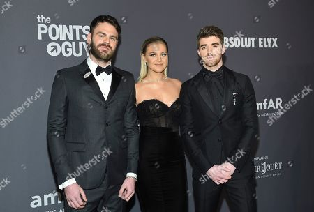 Alex Pall, Kelsea Ballerini, Andrew Taggart. Musicians Alex Pall, from left, Kelsea Ballerini and Andrew Taggart of The Chainsmokers attend the amfAR Gala New York AIDS research benefit at Cipriani Wall Street, in New York