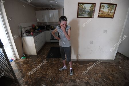 Sue Pollard becomes emotional as she walks around her flood-affected house in the suburb of Hermit Park, in Townsville, Queensland, Australia, 07 February 2019. Residents have begun cleaning up after days of torrential rain, which caused flooding and unprecedented water releases from the city?s swollen dam, sending torrents of water down the Ross River and into the city.