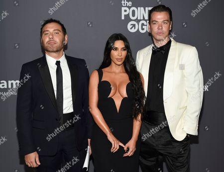 Stock Image of Mert Alas, Kim Kardashian West, Marcus Piggott. Mert Alas, left, Kim Kardashian West and Marcus Piggott attend the amfAR Gala New York AIDS research benefit at Cipriani Wall Street, in New York
