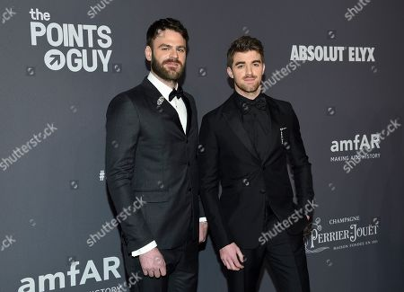 Alex Pall, Andrew Taggart. Musicians Alex Pall, left, and Andrew Taggart of The Chainsmokers attend the amfAR Gala New York AIDS research benefit at Cipriani Wall Street, in New York
