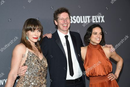 Milla Jovovich, Paul W. S. Anderson, Michelle Rodriguez. Actress Milla Jovovich, left, and husband Paul W. S. Anderson pose with actress Michelle Rodriguez at the amfAR Gala New York AIDS research benefit at Cipriani Wall Street, in New York