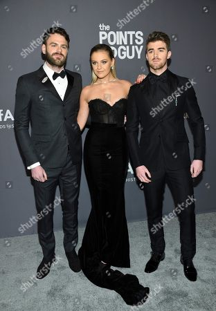 Alex Pall, Kelsea Ballerini, Andrew Taggart. Musicians Alex Pall, left, Kelsea Ballerini and Andrew Taggart of The Chainsmokers attend the amfAR Gala New York AIDS research benefit at Cipriani Wall Street, in New York