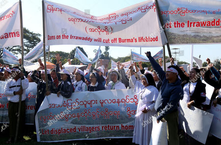 People from Kachin State shout slogan and hold placards during a protest held to show opposition to the Irrawaddy Myitsone Dam project in Myitkyina, Kachin State, Myanmar, 07 February 2019. The project is being built by the Myanmar government and the China Power Investment Corporation (CPI), and if completed it would be the fifteenth largest hydroelectric power plant in the world. In 2011, former Myanmar president Thein Sein announced that the project was to be suspended due to protests from locals and environmentalists. The project began in 2009 and was scheduled to be completed in 2017.