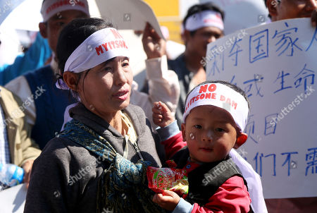 A woman holds her son as she during a protest held to show opposition to the Irrawaddy Myitsone Dam project in Myitkyina, Kachin State, Myanmar, 07 February 2019. The project is being built by the Myanmar government and the China Power Investment Corporation (CPI), and if completed it would be the fifteenth largest hydroelectric power plant in the world. In 2011, former Myanmar president Thein Sein announced that the project was to be suspended due to protests from locals and environmentalists. The project began in 2009 and was scheduled to be completed in 2017.