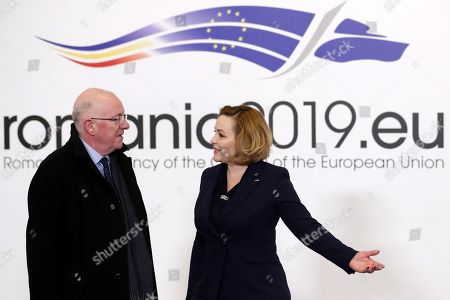 Stock Image of Irenland's Minister of Justice & Equality, Charles Flanagan (L) is welcomed by the Romanian Internal Affairs Minister, Carmen Dan (R), at the beginning of the EU Internal Affairs and Justice Ministers informal meeting at the Parliament Palace in Bucharest, Romania, 07 February 2019.