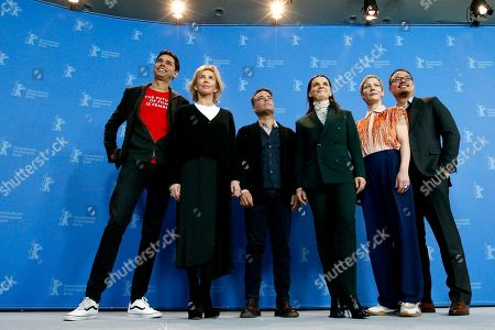 From left, the members of the jury Rajendra Roy, Trudie Styler, Sebastian Lelio, Juliette Binoche, Sandra Huller and Justin Chang pose for the photographers during a photo call at the 2019 Berlinale Film Festival in Berlin, Germany