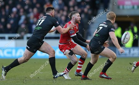 Salford Red Devils v London Broncos 10.2.2019 Jackson Hastings of Salford Red Devils passes through James Cunningham of London Broncos and Will Lovell of London Broncos