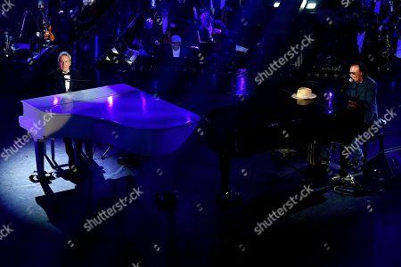 Italian singer and Sanremo Festival artistic director Claudio Baglioni (L) and Italian singer Antonello Venditti (R) perform on stage at the Ariston theatre during the 69th Sanremo Italian Song Festival, Sanremo, Italy, 07 February 2019. The festival runs from 05 to 09 February.