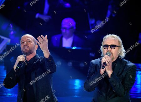 Italian singers Raf (L) and Umberto Tozzi (R) perform on stage at the Ariston theatre during the 69th Sanremo Italian Song Festival, Sanremo, Italy, 07 February 2019. The Festival runs from 05 to 09 February.