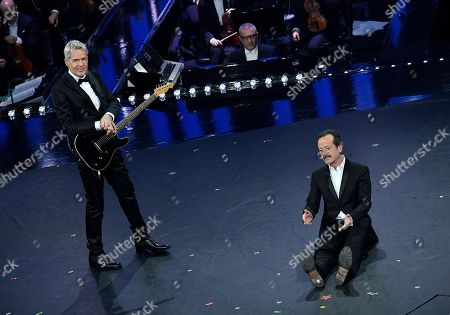 Italian singer and Sanremo Festival artistic director Claudio Baglioni (L) and Italian actor Rocco Papaleo (R) perform on stage at the Ariston theatre during the 69th Sanremo Italian Song Festival, Sanremo, Italy, 07 February 2019. The Festival runs from 05 to 09 February.