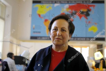 Iranian Nobel Peace laureate Shirin Ebadi poses during a news conference on Iran at the Reporters without Borders (RSF) offices in Paris, France,. The media advocacy group Reporters Without Borders says that 860 journalists were detained by Iran over 30 years period, starting with the inception in 1979 of the Islamic Republic. The organization revealed on Thursday its macabre headcount of named journalists and citizen-journalists detained around Tehran, the capital, some of them executed, in what it said was a first