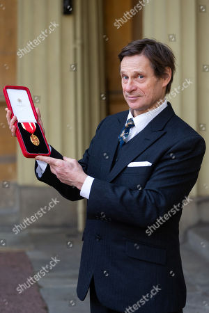 Baritone Sir Simon Keenlyside Poses with his Knights Bachelor medal after being knighted at an investiture by HRH The Prince of Wales at Buckingham Palace in London.