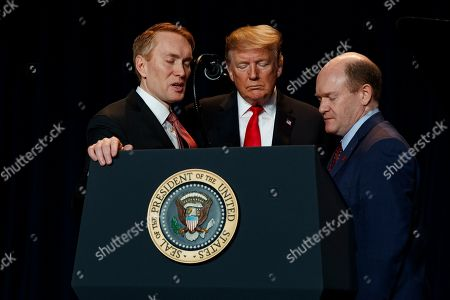 Rep. James Lankford, R-Okla., left, President Donald Trump, center, and Sen. Christopher A. Coons, D-Del., pray during the National Prayer Breakfast, in Washington