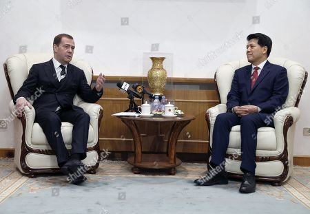 Stock Photo of Russian Prime Minister Dmitry Medvedev (L) speaks with Chinese Ambassador to Russia Li Hui (R) during a meeting at the Chinese embassy in Moscow, Russia, 07 February 2019.