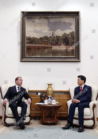 Russian Prime Minister Dmitry Medvedev (L) speaks with Chinese Ambassador to Russia Li Hui (R) during a meeting at the Chinese embassy in Moscow, Russia, 07 February 2019.