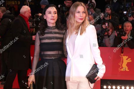 Nora von Waldstatten (R) and Sibel Kekilli arrive for the opening ceremony of the 69th annual Berlin International Film Festival in Berlin, Germany, 07 February 2019. The Berlinale runs from 07 to 17 February.