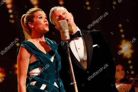 Anke Engelke (L) and Max Raabe sing during for the opening ceremony of the 69th annual Berlin International Film Festival in Berlin, Germany, 07 February 2019. The Berlinale runs from 07 to 17 February.