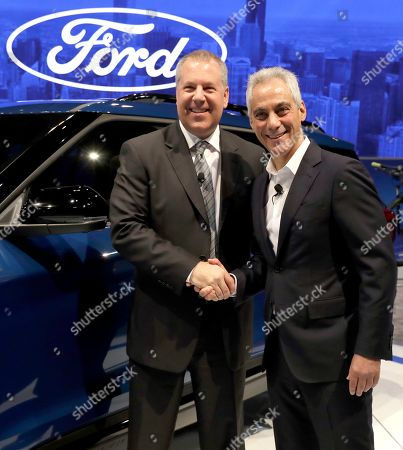 Joe Hinrichs, Rahm Emanuel. Ford Ford's president of global operations of the Americas for Ford Motor Company, Joe Hinrichs, left, shakes hands with Chicago Mayor Rahm Emanuel during the media preview of the Chicago Auto Show at McCormick Place, in Chicago. Ford Motor Company said Thursday that it will invest $1 billion in its Chicago-area manufacturing operations to expand production of its Ford Explorer and Lincoln Aviator sport utility vehicles