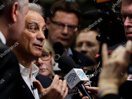 Chicago Mayor Rahm Emanuel talks to media during the media preview of the Chicago Auto Show at McCormick Place, in Chicago. Ford Motor Company said Thursday that it will invest $1 billion in its Chicago-area manufacturing operations to expand production of its Ford Explorer and Lincoln Aviator sport utility vehicles. The announcement, made at the Chicago Auto Show, will add 500 jobs to two manufacturing facilities, the assembly plant and stamping plant, said Joe Hinrichs, Ford's president of global operations