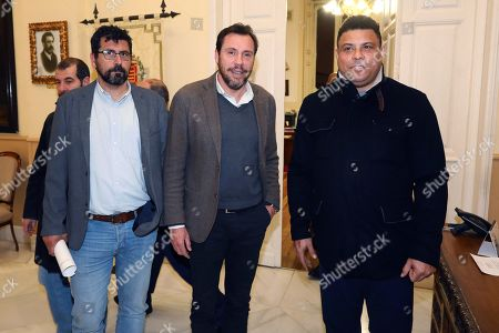 Valladolid CF's President, Brazilian Ronaldo Nazario (R), and Valladolid's Regional President, Oscar Puente (C), attend a meeting in Valladolid, northern Spain, 07 February 2019.