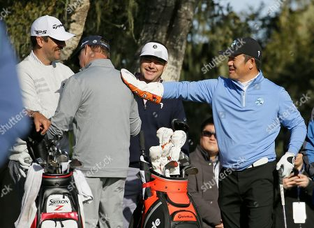 Ho-Sung Choi, Jerry Kelly, Aaron Rodgers, Chris O Donnell. Ho-sung Choi, of South Korea, uses a club cover to rub the back of Jerry Kelly as Aaron Rodgers, left, and Chris O Donnell, second from right, watches on the third tee of the Monterey Peninsula Country Club Shore Course during the first round of the AT&T Pebble Beach National Pro-Am golf tournament, in Pebble Beach, Calif