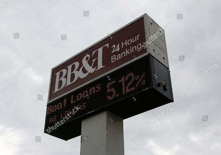 A sign for a BB&T bank branch in Rockwall, Texas, USA, 07 February 2019. Media reports on 07 February 2019 state SunTrust and BB&T banks are to merge in a 66 billion US dollar deal, creating a bank with 442 billion US dollar in assets. Both banks said the merger would enable them to save net costs of some 1.6 billion USD by 2022. BB&T chairman and chief executive Kelly King is to keep his title and position in the merged entity until 2021 when SunTrust chief William Rogers takes over as group chied executive.