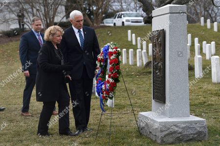 Stock Picture of Mike Pence, June Scobee-Rodgers, Jim Bridenstine. Vice President Mike Pence, right, walks with June Scobee-Rodgers, center, widow of Challenger Commander Dick Scobee, and NASA Administrator Jim Bridenstine, left, to see the Challenger memorial during the NASA Day of Remembrance ceremony at Arlington National Cemetery in Arlington, Va., . The space shuttle Challenger was lost just after its liftoff, killing astronauts Dick Scobee, Michael Smith, Judy Resnik, Ellison Onizuka, Ron McNair, Greg Jarvis, and Christa McAuliffe. McAuliffe was set to be the first teacher in space during the mission