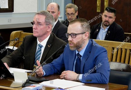 Andy Jones, right, director of the Alaska Office of Substance Misuse and Addiction Prevention, speaks before the Senate Finance Committee, in Juneau, Alaska. Shown beside him is Michael Duxbury, deputy commissioner of the state Department of Public Safety